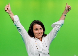 French Green Party leader Cecile Duflot gives the thumbs-up after delivering a speech during a meeting in Lyon