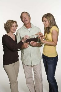 parents-giving-money-to-daughter-w352